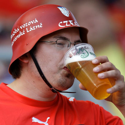 A Czech football fan enjoys a beer