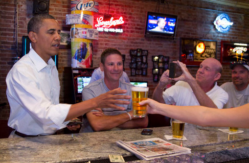 President Obama enjoys a beer