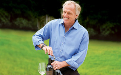 Greg Norman with one of his bottles of wine
