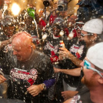 The Washington Nationals celebrate by spraying each other with beer and champagne