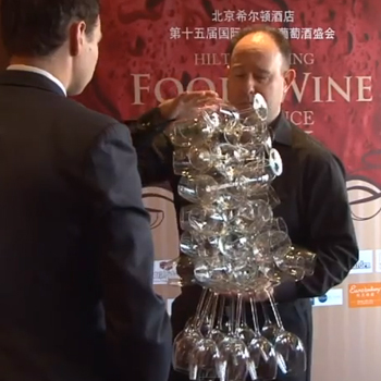 Philip Osenton breaks the world record for the most wine glasses held in one hand
