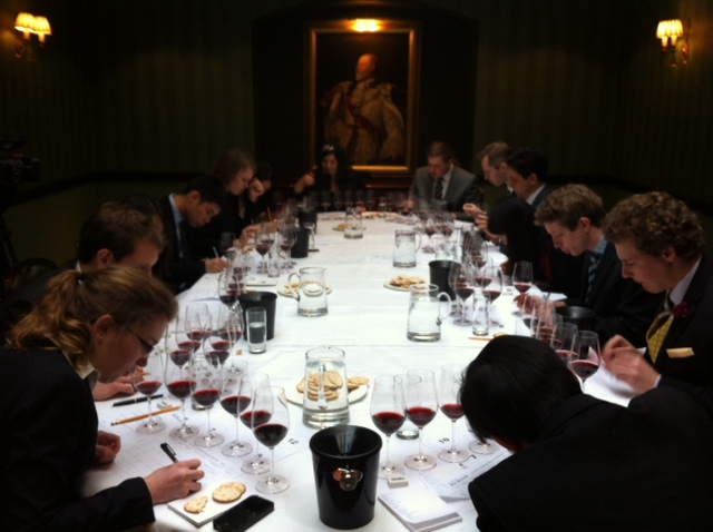 The Oxford and Cambridge teams tackle the red wine flight