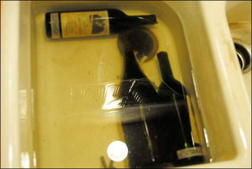 Wine bottles found soaking in the sink at Kurniawan's home