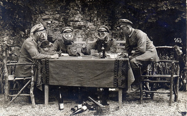 ncos-from-infanterie-regiment-nr-358-drink-wine-feast-on-gherkins-and-play-cards-whilst-wearing-gas-masks-late-in-the-great-war