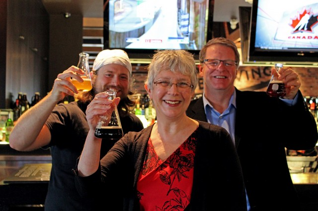 Dean Elizabeth Worobec, faculty of science and horticulture, shares beakers of beer with Nick Bolton (left), head brewer with Surrey's Big Ridge Brewing Co., and Ken Beattie, executive director of the BC Craft Brewers Guild, while celebrating the program's announcement at the Surrey brewpub.