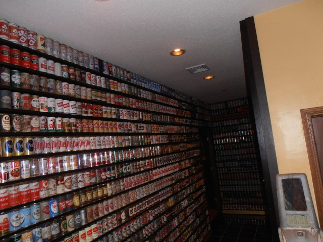 A wall of US flat top cans.