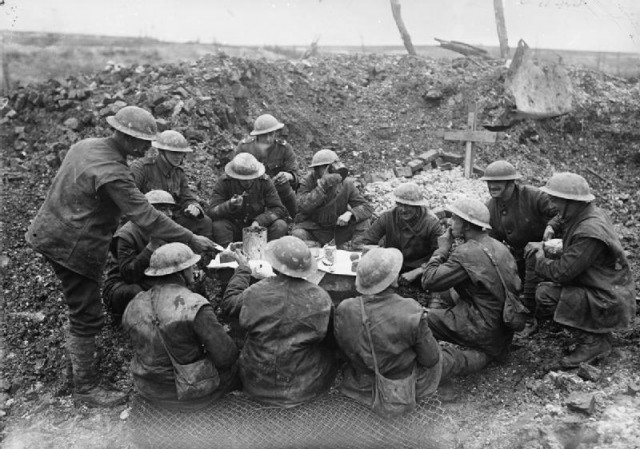 British-troops-eating-their-Christmas-dinner-in-a-shell-hole-Beaumont-Hamel-25th-December-1916-q-1630