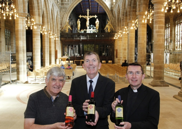 Canon Michael Rawson, fundraiser Terry Rigg and Jeremy Stokes of Clarks Fine Wine