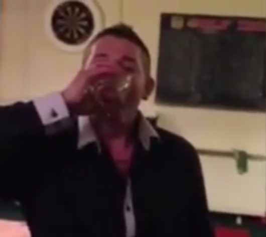 Paul Wooding is seen drinking a live fish in an alcoholic drink in an online video (Photo: YouTube)