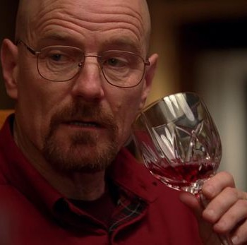 Bryan Cranston as Meth manufacturer Walter White in hit TV show Breaking Bad, enjoying a glass of wine.