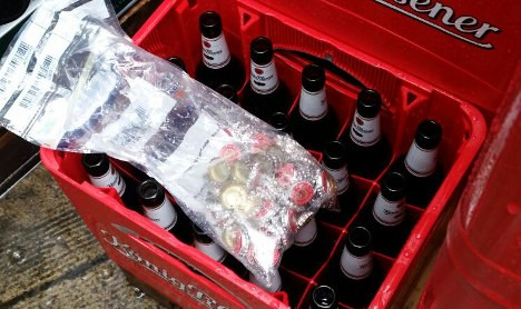 Police found dozens of bottle caps on the floor near the crates of beer (Photo: Police Essen)