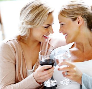 Lovely lesbian couple celebrating with wine