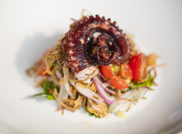 Grilled octopus with banana blossom salad