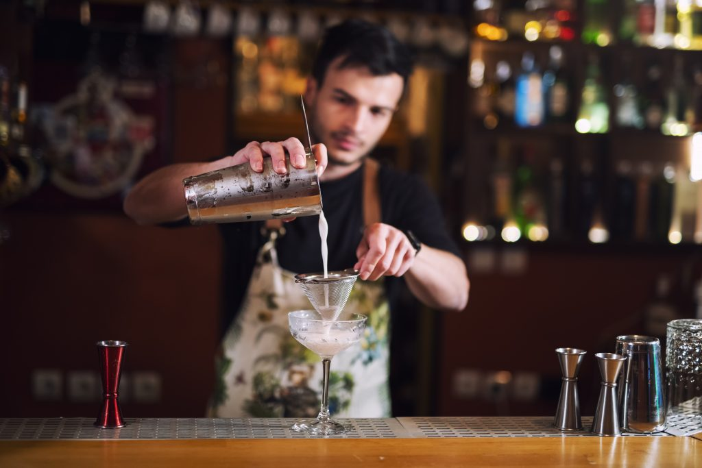 Bartender pouring drink: Bartenders reveal the drinks they secretly hate making