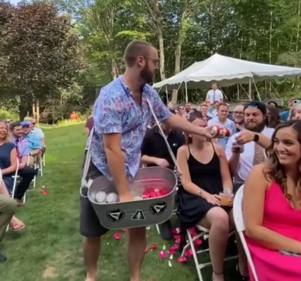 'beer boy' hands out beers at wedding ceremony