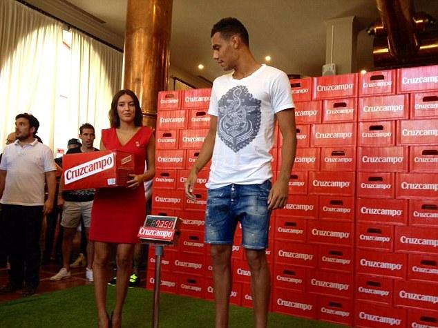 Sevilla's Timothee Kolodziejczak, picking up his prize despite playing for French side Nice last season