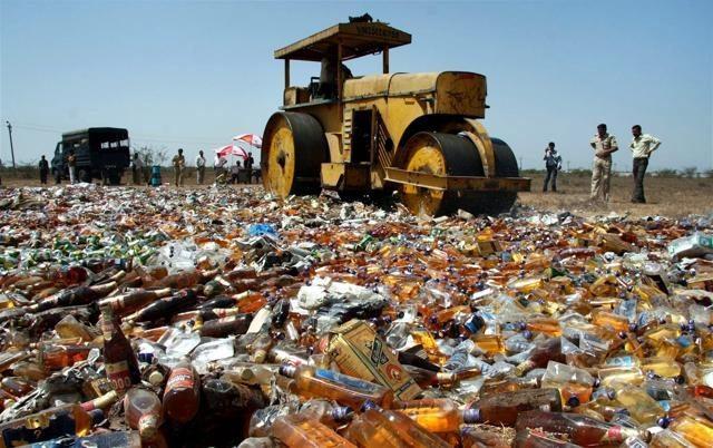 crushing liquor bottles